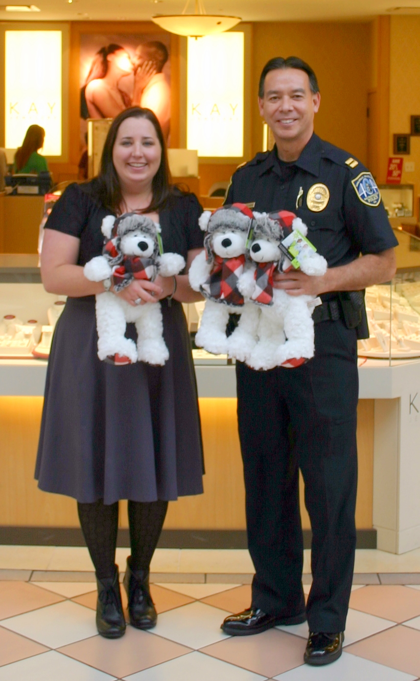 Kay manager Karen Campbell donates bears to SCMPD Southside Precinct Commander Capt. Dean Fagerstrom