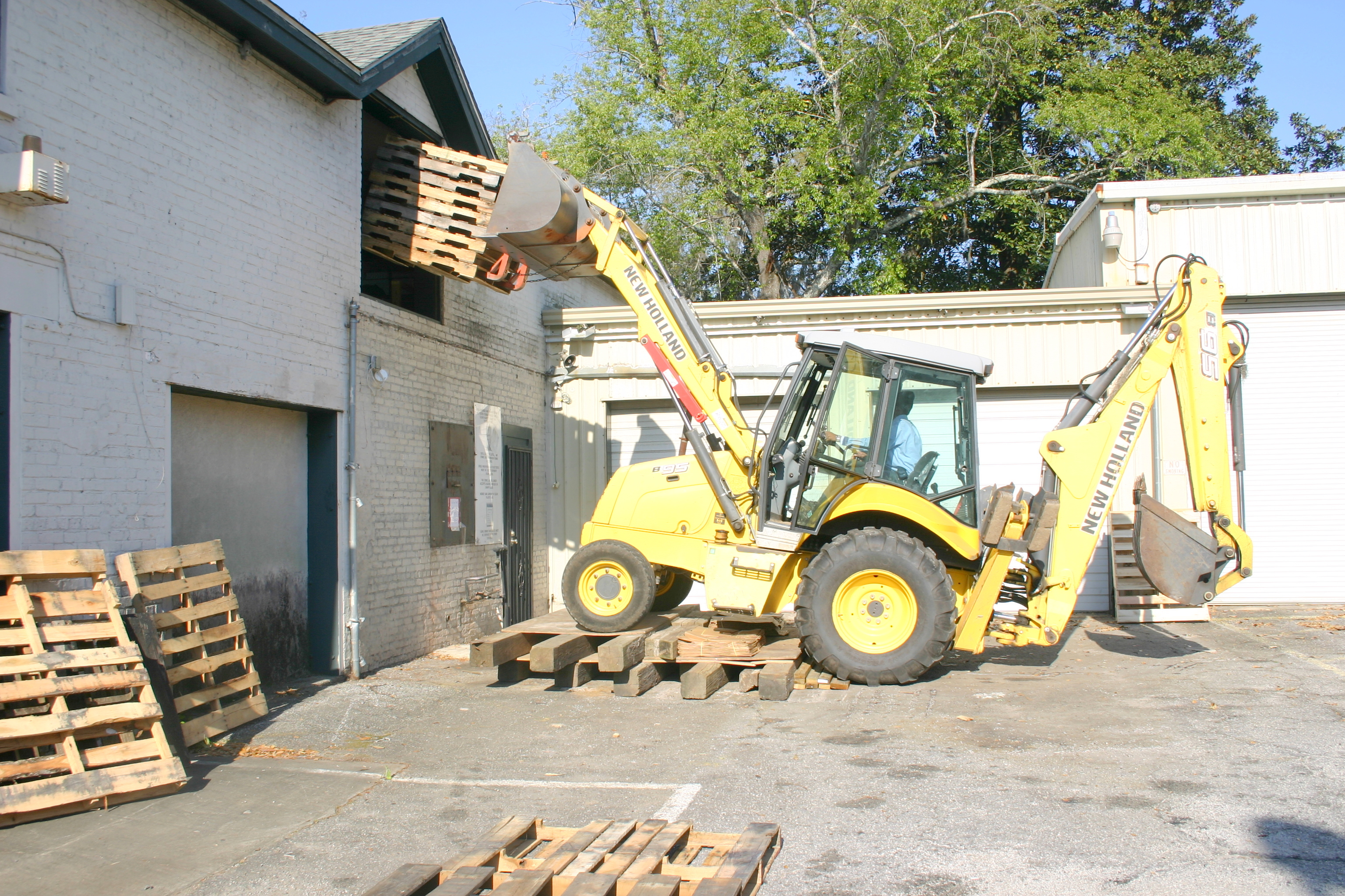 Front end loader is used as a forklift during the moving process.