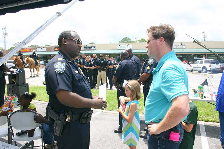 Capt. DeVonn Adams talks with Ardsley Park residents as Roll Call on Habersham Street takes place.