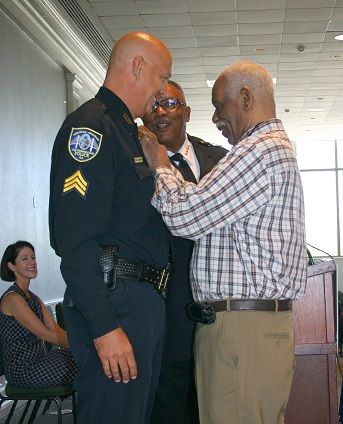 Sgt  Bill Sharpley is Pinned by 50-year Detective Clifford Perry.