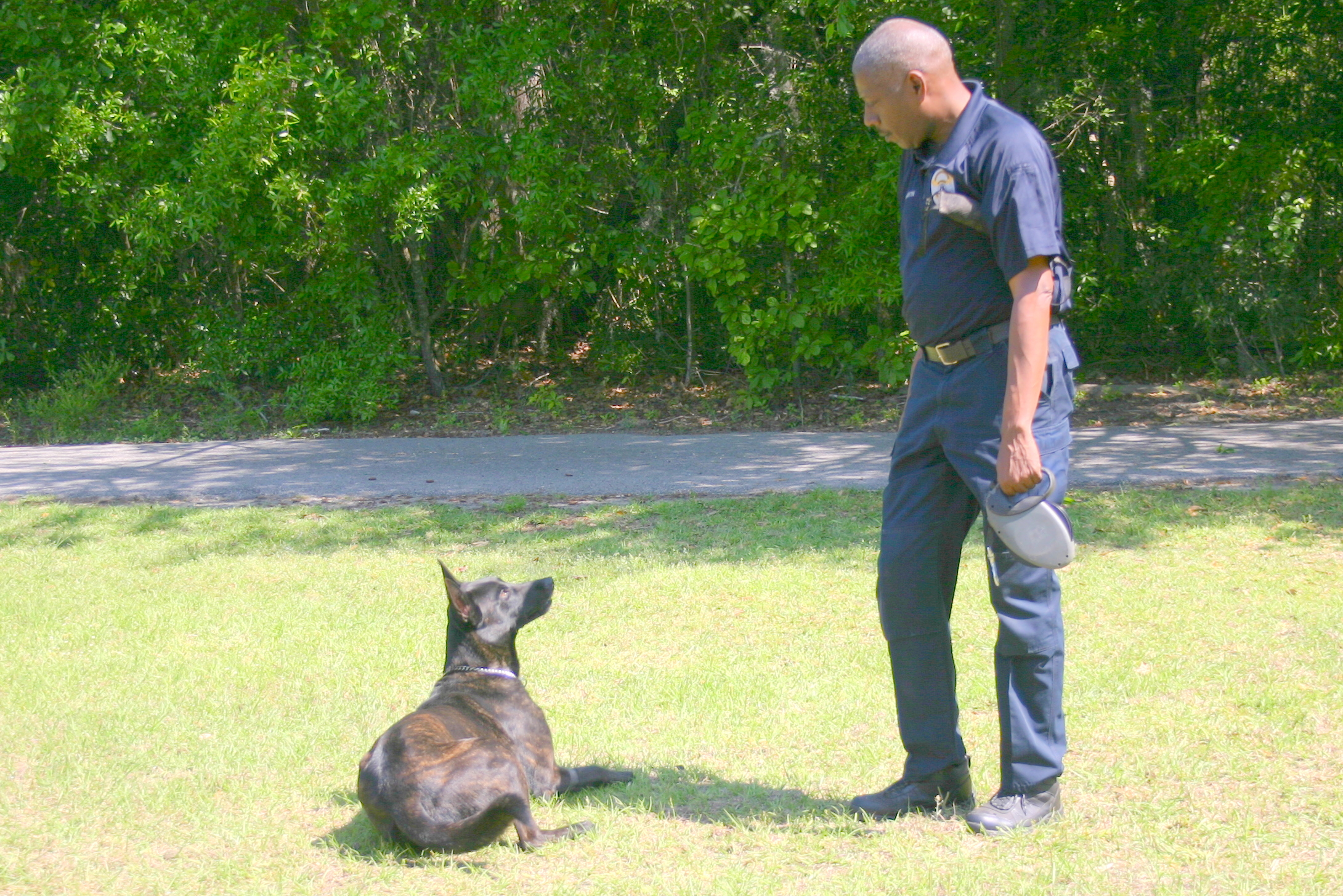 Ziggy signals to his partner Ofc. Mike Drayton that he has found a shell casing.